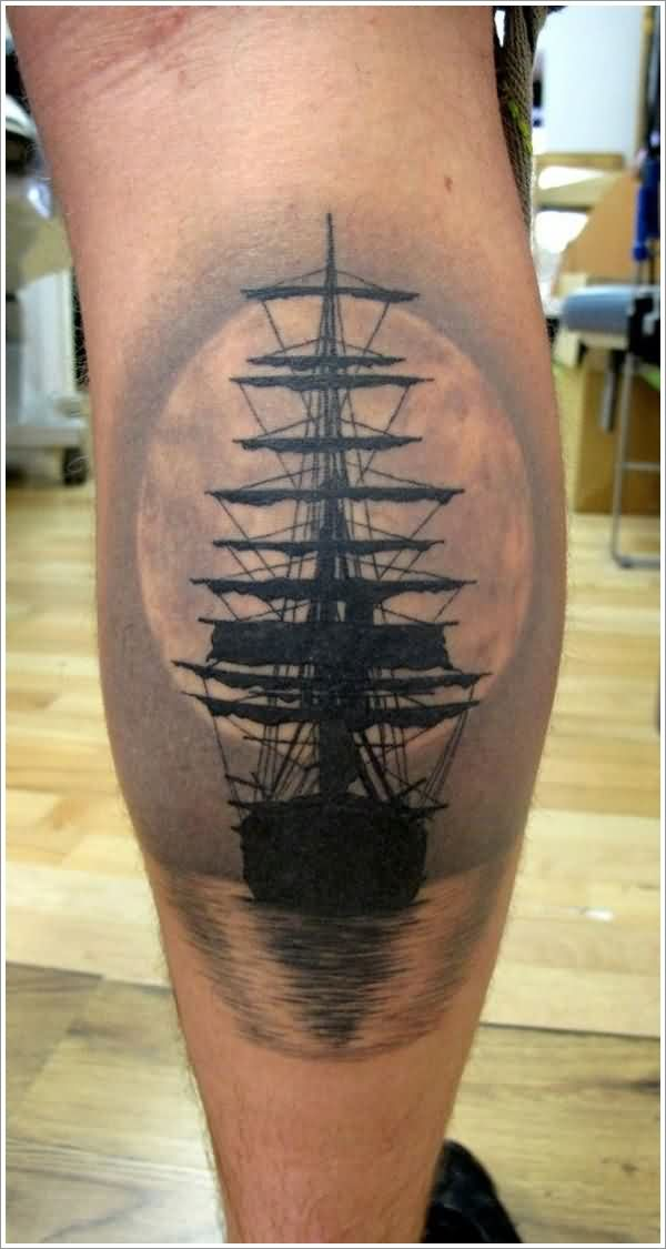 Realistic Black Ship In Water Tattoo On Leg