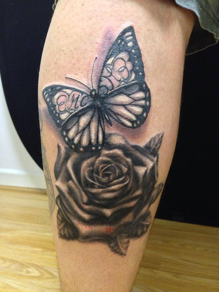 Realistic Butterfly And Grey Rose Tattoos On Leg