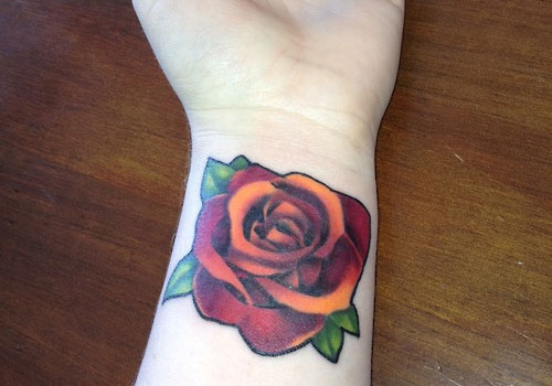 Realistic Red-Orange Rose Tattoo On Wrist