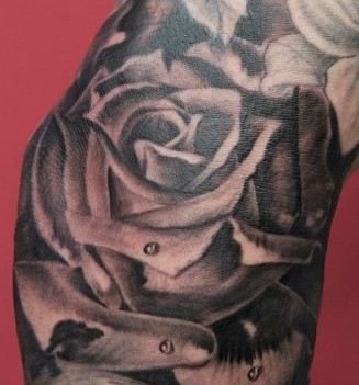 Realistic Rose Tattoo On Elbow