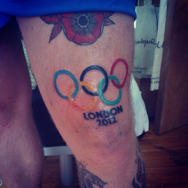 Red Flower And Olympic Logo Tattoos