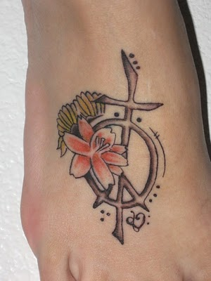 Red Flower And Peace Symbol Tattoos On Foot