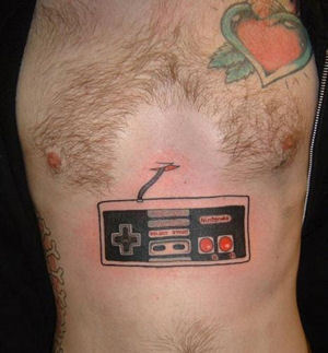 Red Heart And Nintendo Controller Tattoos On Upperbody