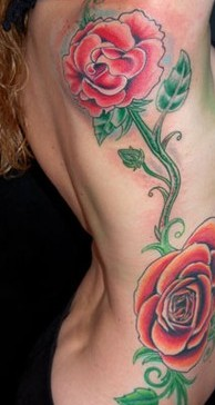 Red Rose Vine Tattoo On Ribs