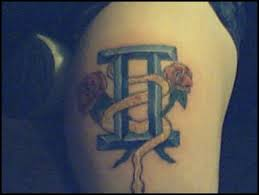 Red Roses With A Gemini Symbol Tattoo