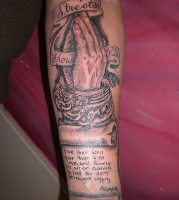 Religious Praying Hands And Scroll Tattoos On Arm