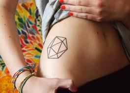 Revealing A Outline Symbol Tattoo On Hip