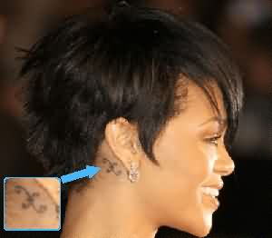 Rihanna's Back Ear Pisces Symbol Tattoo