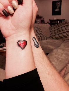 8 Bit Heart And Sword Tattoos On Wrist