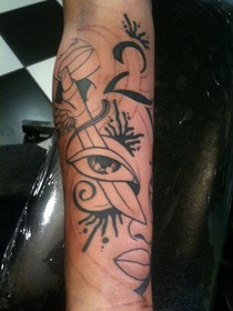 Artistic Sword Eye And Lipstick Tattoos On Arm