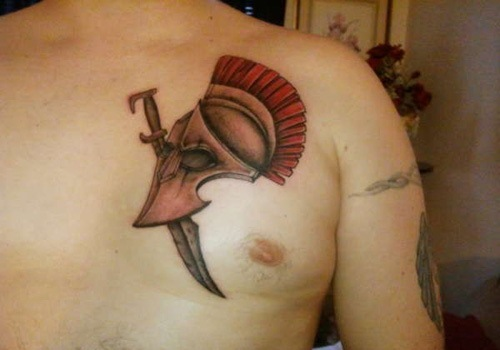 Clean Spartan Head And Sword Tattoos On Chest