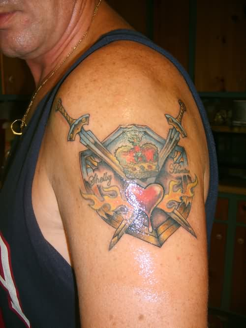 Crossed Sword And Heart Flames Tattoos On Shoulder