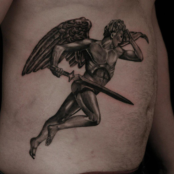 Flying Angel With The Sword Tattoo On Side