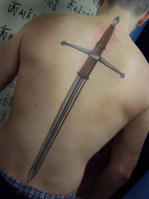 Great Long Sword Tattoo On Spine