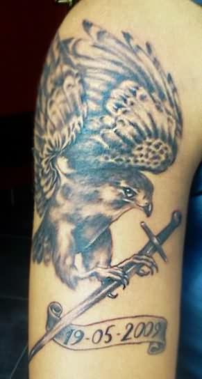 Hawk And Sword Tattoos On Arm