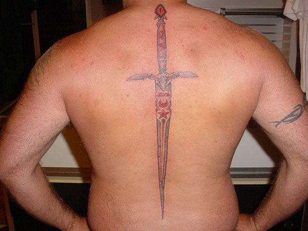 Impressive Sharp Sword Tattoo On The Spine