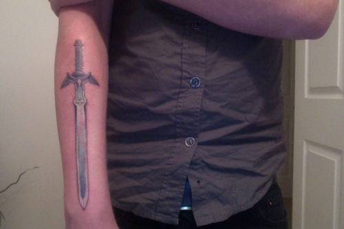 Long Sharp Sword Tattoo On Right Arm