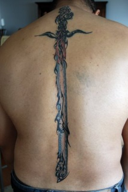 Long Tribal Sword Tattoo On The Spine