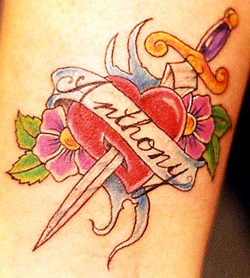 Love Heart With Sword Pink Flowers And Inscription Banner Tattoo