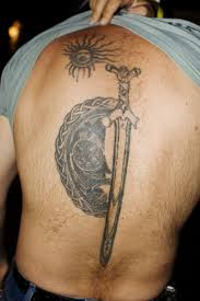 Man Reveals His Sun And Sword Tattoos On Back