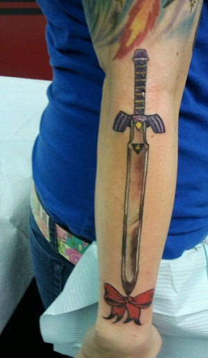 New Sword And Red Bow Tattoos On Arm