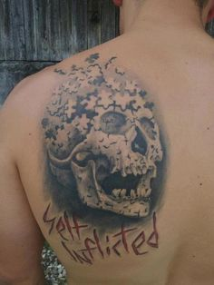 Puzzles From 3D Skull Tattoo On Back Shoulder