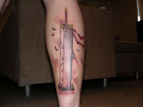 Red Ribbon On Buster Sword Tattoo On Leg