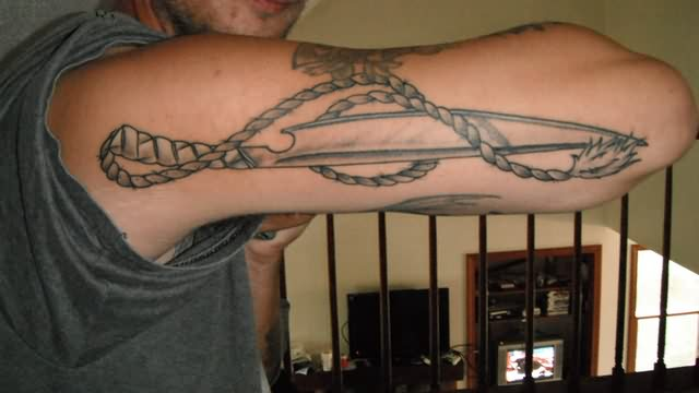 Rope And Sword Tattoos On Arm