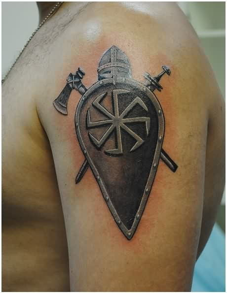 Shield Axe And Sword Tattoos On Upper Arm