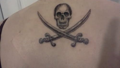 Skull And Cross Sword Tattoos On Upperback