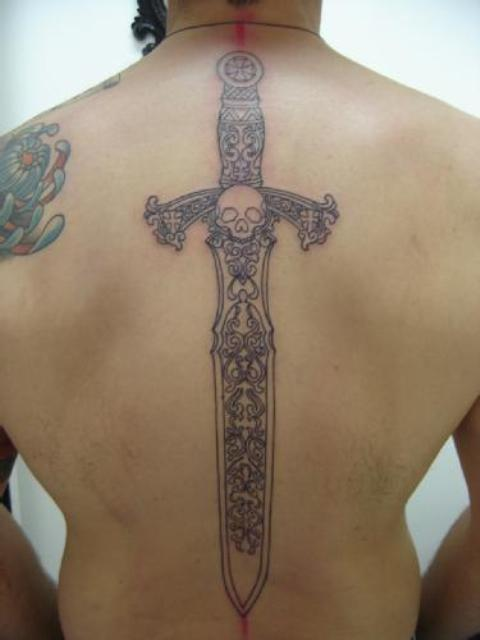 Skull Sword Tattoo On The Spine
