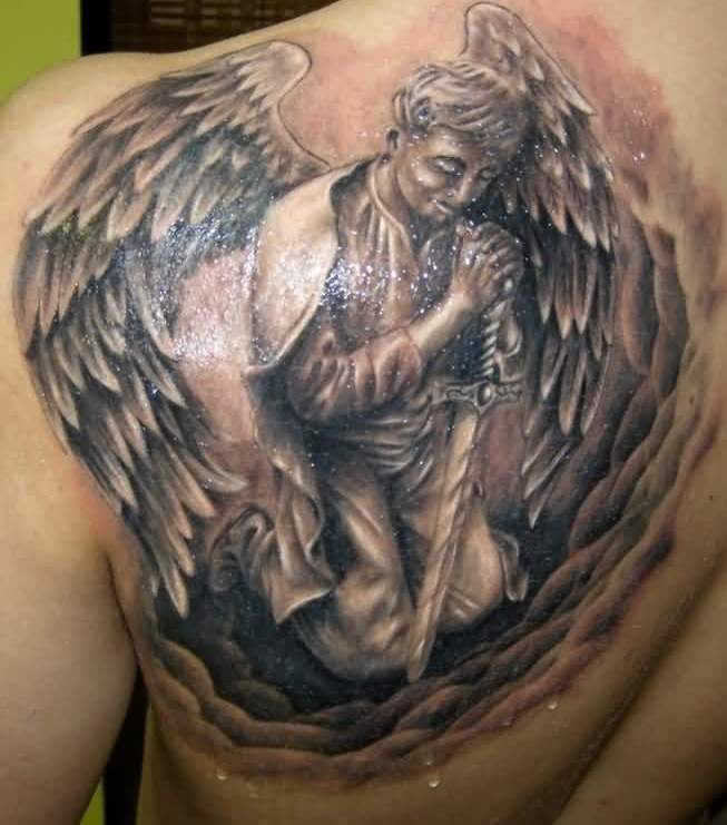 Sparkling Praying Angel With Sword Tattoos On Back Shoulder