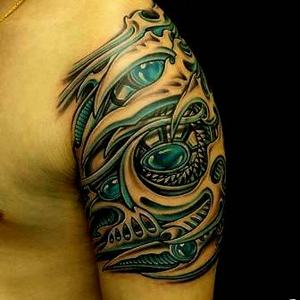 Stunning 3D Tribal Biomechanical Tattoo On Upper Sleeve