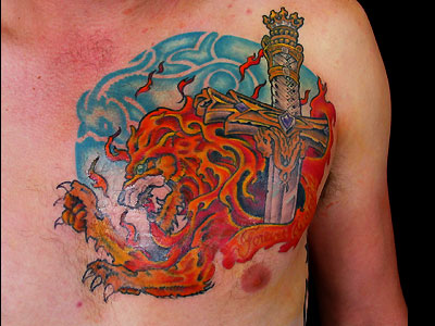 Sword Lion And Flame Tattoos On Chest