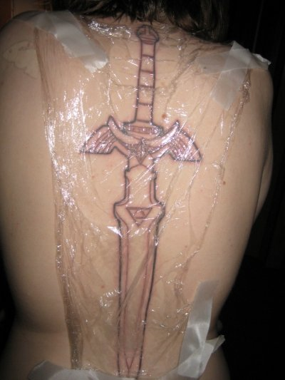 Sword On Spine Tattoo