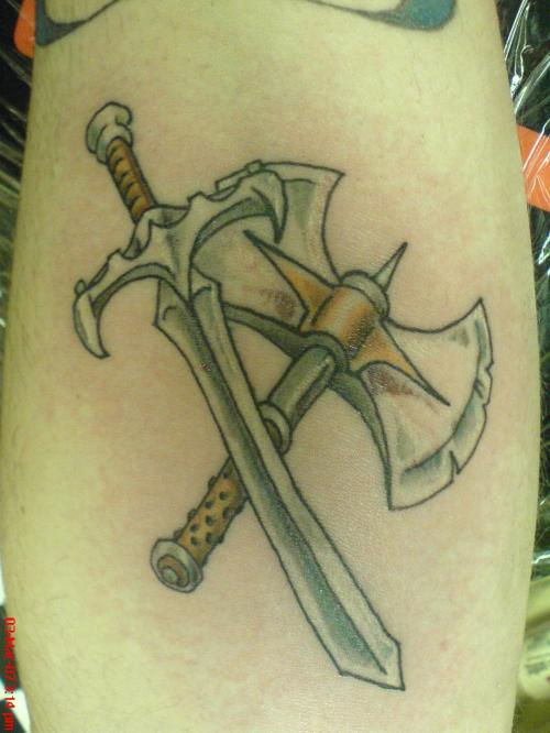 The Incredible Sword And Axe Tattoos