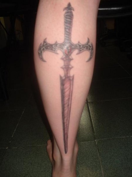 The Incredible Sword Tattoo On Back Leg