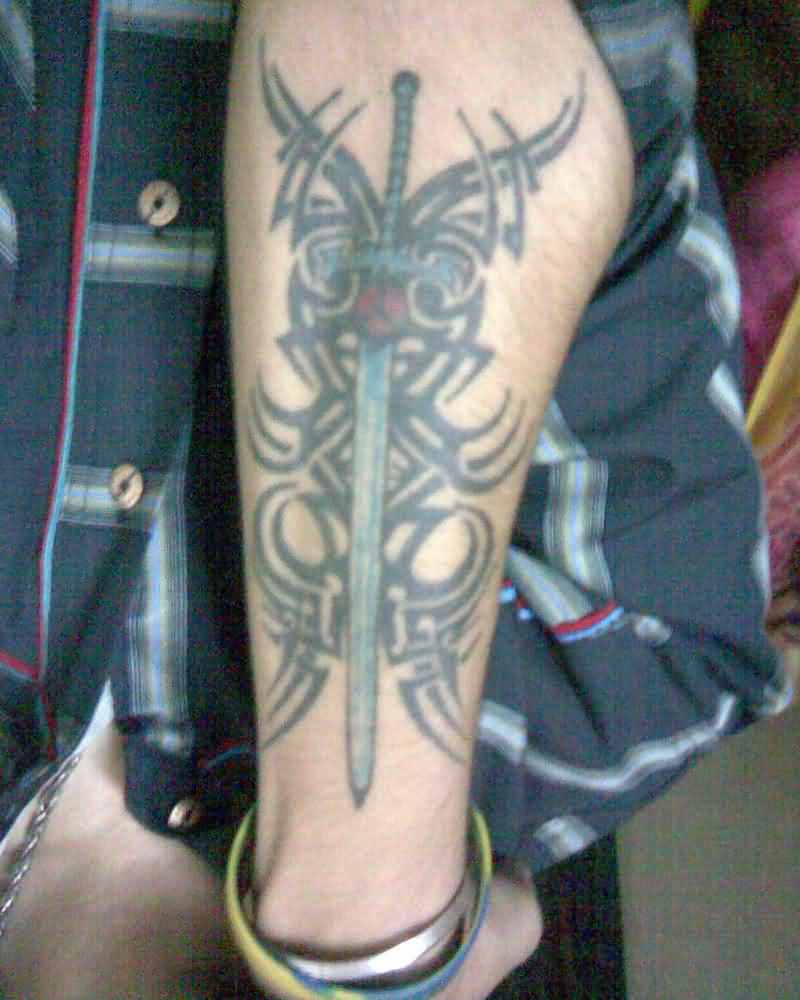Tribal And Sword Tattoos On Arm For Boys