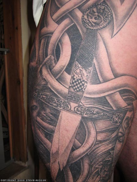 Truly Amazing Celtic Sword Tattoo On Sleeve