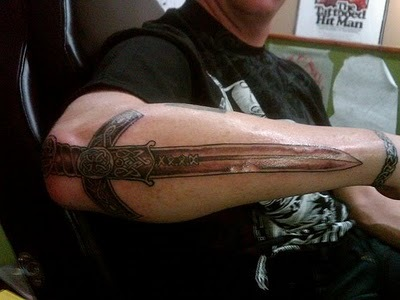 Truly Awesome Celtic Sword Tattoo On Right Arm