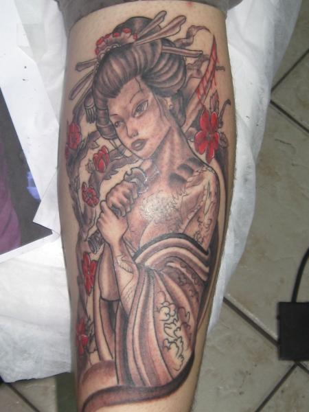 Young Geisha With Bleeding Sword Tattoo On Arm