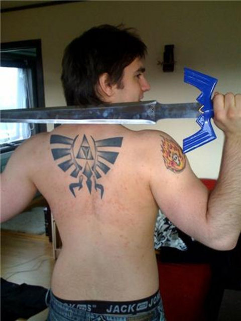 Zelda Sword Tattoo On Upperback