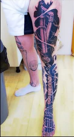 3D Biomechanical Ripped Skin Tattoo On Whole Left Leg