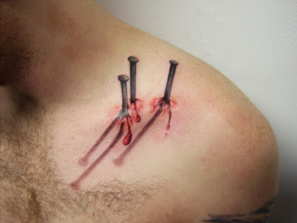 3D Bleeding Nails Tattoos On Collarbone