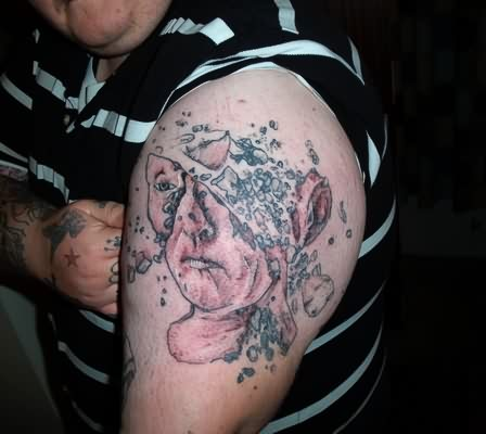 3D Broken Lady Face Tattoo On Biceps