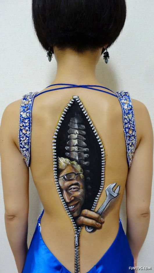 3D Mechanic In Zipper Tattoo On The Spine