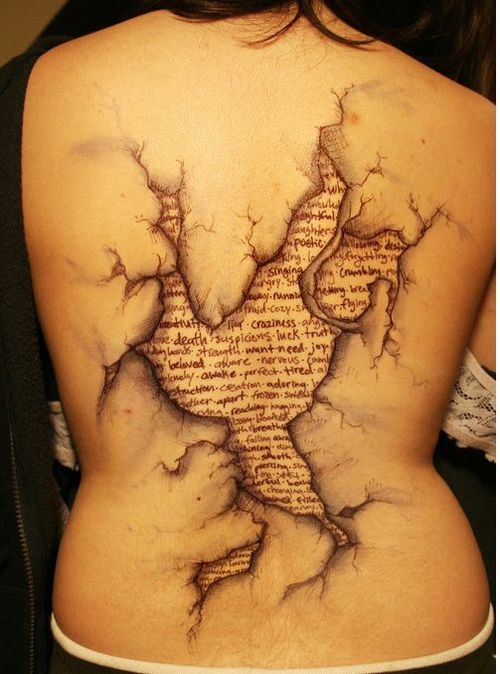 3D Newspaper Lettering Tattoo On Back