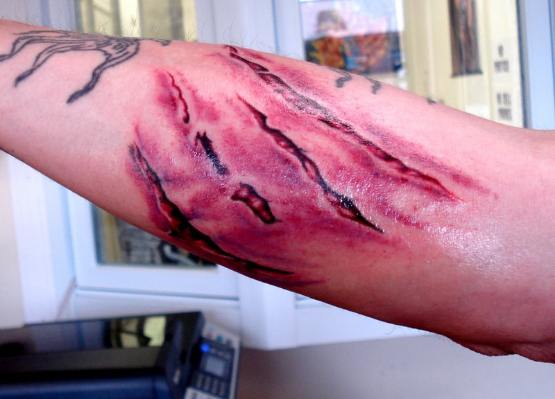3D Rip Skin Scratch Tattoo On Arm