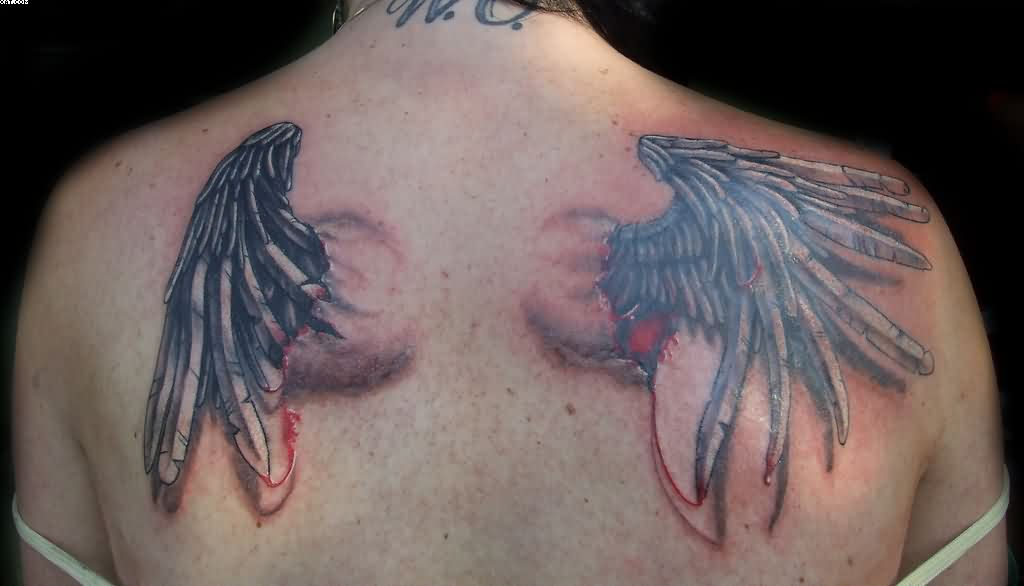 3D Ripped Skin Broken Angel Wings Tattoo On Upper Back