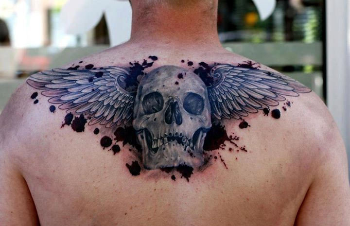 3D Skull With Angel Wings Tattoo On Upperback